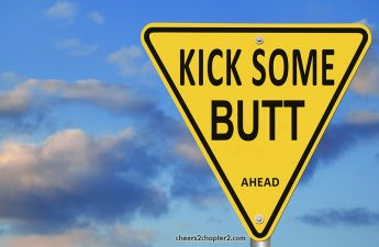 Image of street sign reading kick some butt ahead for positive thinking women over fifty