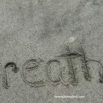 the word breathe written in the sand used for the main image on the the word breathe written in the sand used as the main image for cheers 2 chapter 2 Hearing Your Inner Voice Can Help Ground You to Live a More Positive Life page