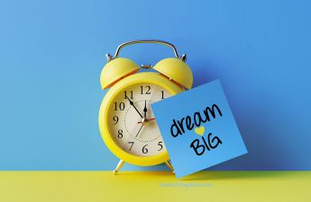 image of clock with dream big sign
