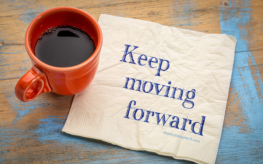 Image of coffee mug and napkin with words Keep Moving Forward - used as image for Cheers to Chapter Two Mindset Matters Tiny Steps Lead to Success page
