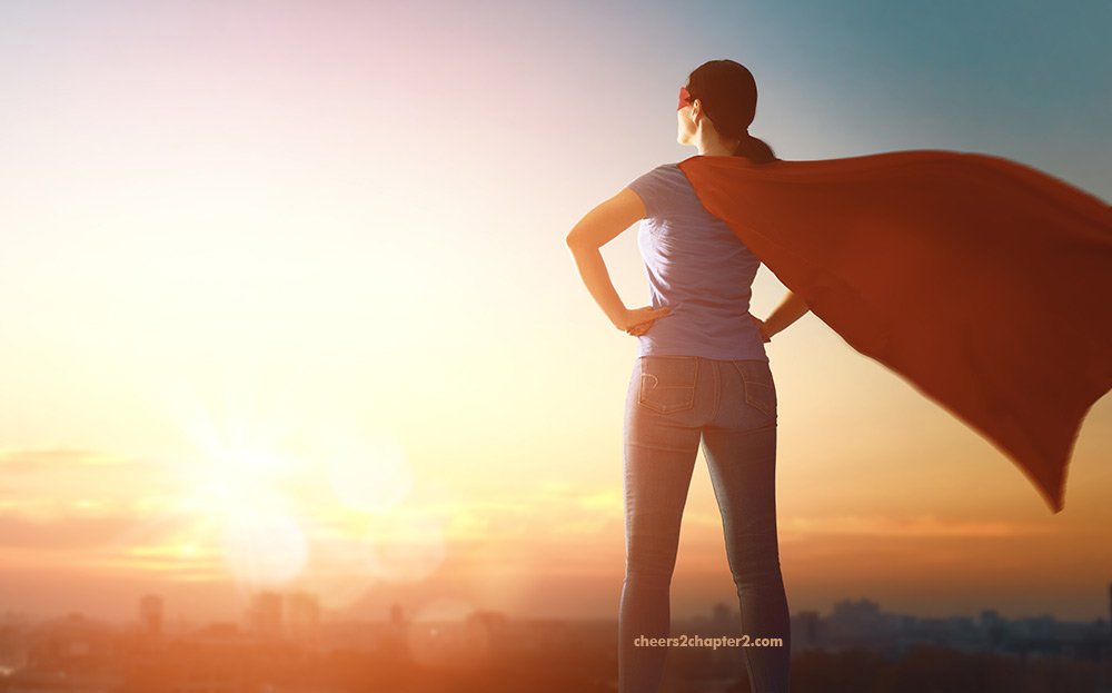 Image of midlife woman with red superwoman cape on looking powerful