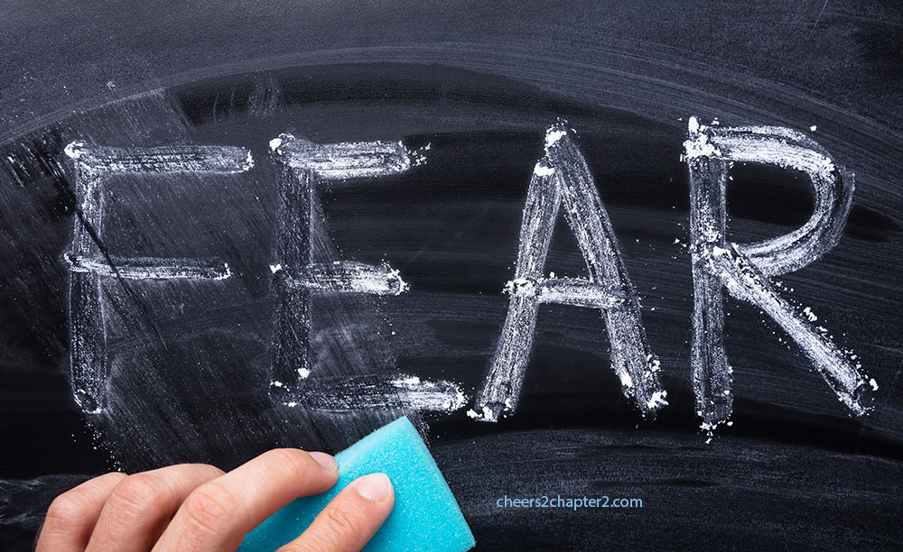 image of chalkboard with the word fear written on it and partially erased