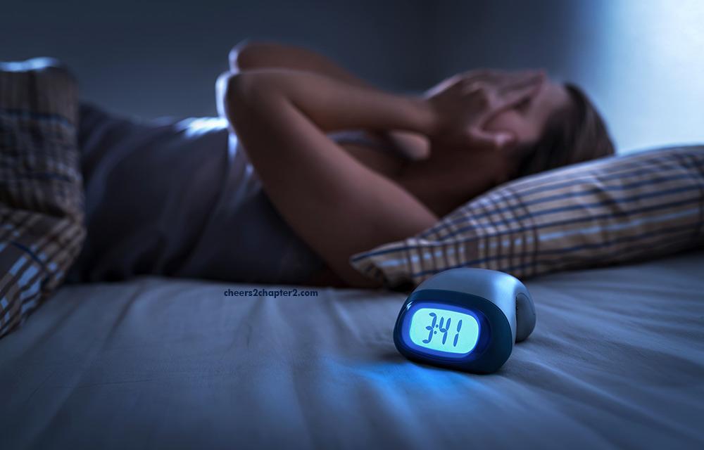 image of woman not able to sleep needing holistic remedies for sleep