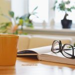 Image of tea cup, book and reading glasses - restful breaks increase productivity