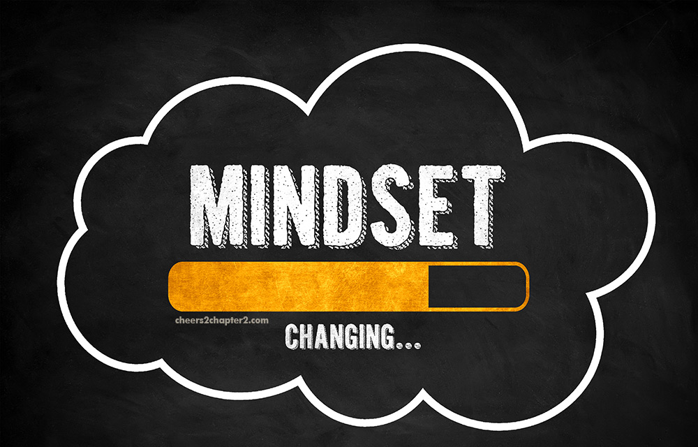 Image of chalkboard with words Mindset Changing for Cheers 2 Chapter 2 Using Mindset to Achieve Goals page
