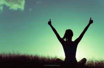 Image of woman with arms up in joy and victory for live your best life despite challenges