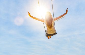 Image of midlife woman swinging free from Feeling Emotionally Stuck? Tips to Break out of that Rut