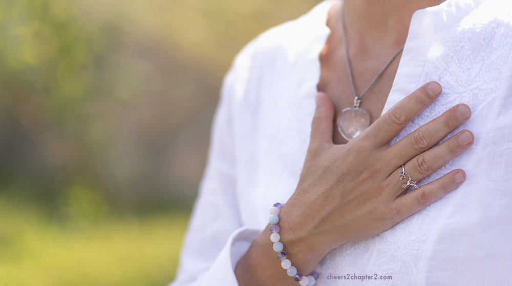 Woman's hand on her chest handling emotional triggers feeling calm