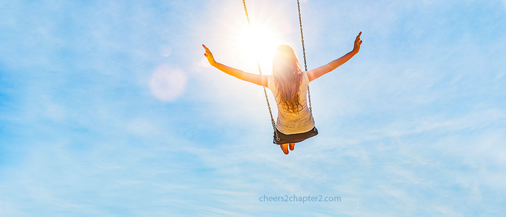 Image of woman on swing in sunshine for Cheers 2 chapter 2 Simple Secret to Happiness page