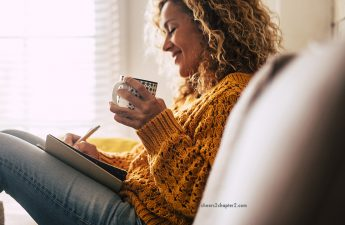 Woman sipping tea and writing in a journal smiling for cheers 2 chapter 2 how to nurture yourself page