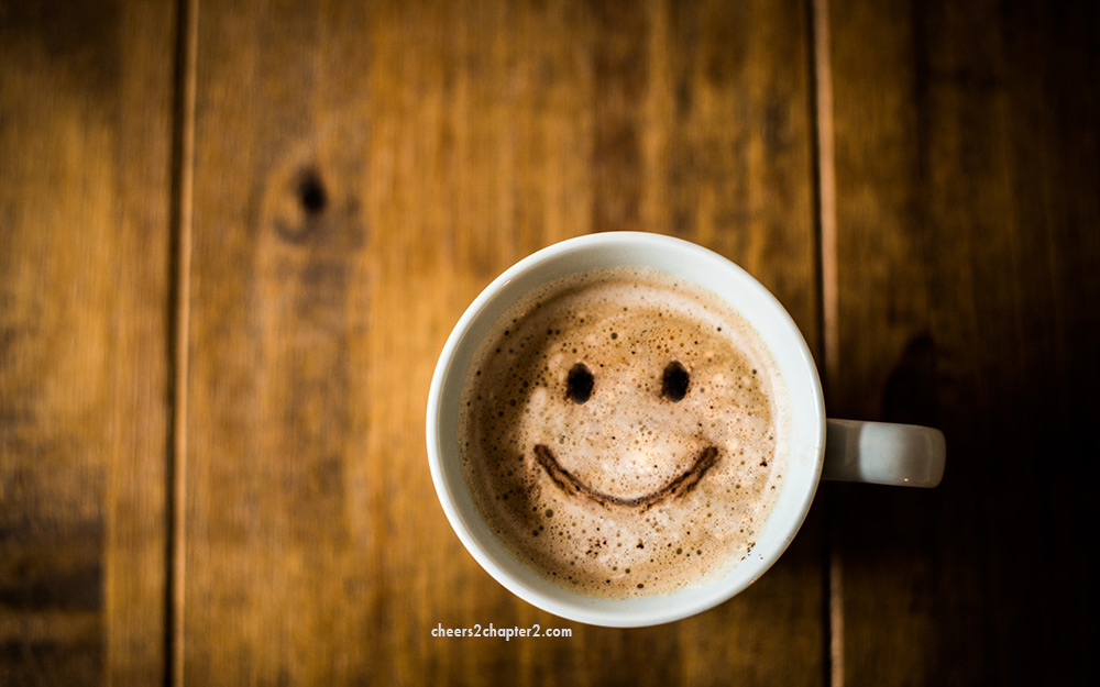 Mug of coffee with smiley face for the Feel Good Experiment page Cheers to Chapter Two