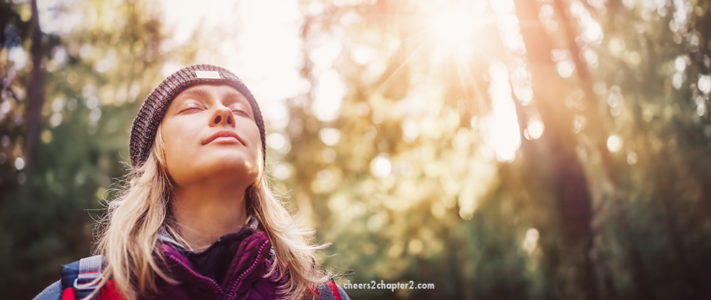 Woman with eyes closed looking calm finding peace